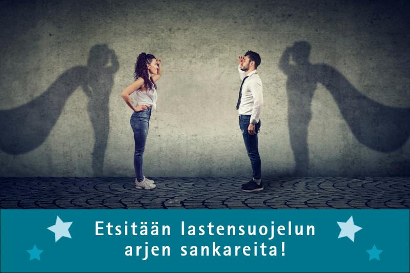 Mies ja nainen seisovat vastakkain tähyillen toisiaan. Heidän varjoissaan on supersankarin viitat.
